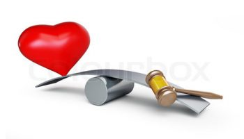 heart and gavel balances on a white background